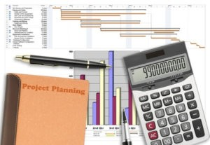 image of project schedule analysis with pen, calculator and notebook